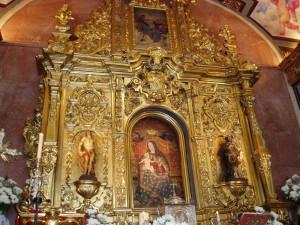 Imagen de la Virgen de la Cinta en su altar.