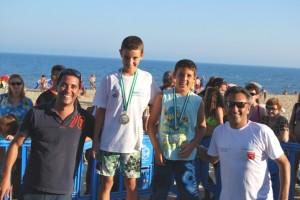 El Concejal de Deportes, Juan García junto a los ganadores infantil Javier García, Pepe Orta y Suharri Gómez