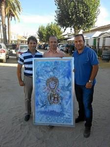 El grupo 'Cantares', con el cartel de la Magna Rociera.
