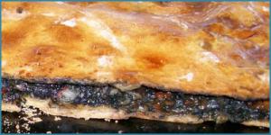 Empanada de choco en su tinta. / Foto: cocinagallega.es.