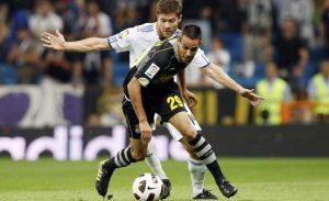 Manu Molina, en un lance de un partido ante el Real Madrid. / Foto: www.recreativohuelva.com.