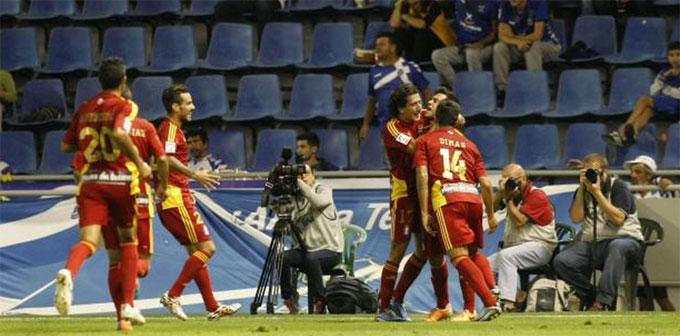 Los jugadores del Recre celebran el primer gol de Joselu. / Foto: www.lfp.es.