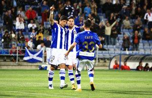 Los jugadores del Recre celebran el tanto del empate, obra de Caye Quintana. / Foto: Josele Ruiz.