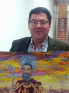 El alcalde de Trigueros, con el cartel de las fiestas.
