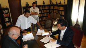 Firma del nuevo convenio.