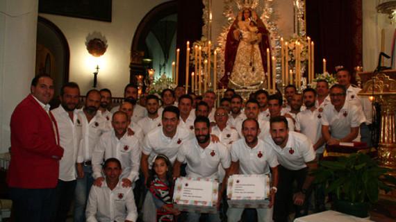 La AD Cartaya hace su presentación y la Ofrenda floral a la Virgen del Rosario