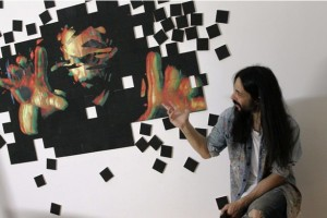 El pintor, ante una de sus obras.