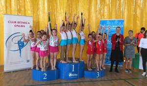 Represetantes del GR Onuba en el podio en el Torneo de Bollullos.