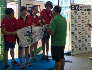 Componentes del CODA Huelva, en el podio.